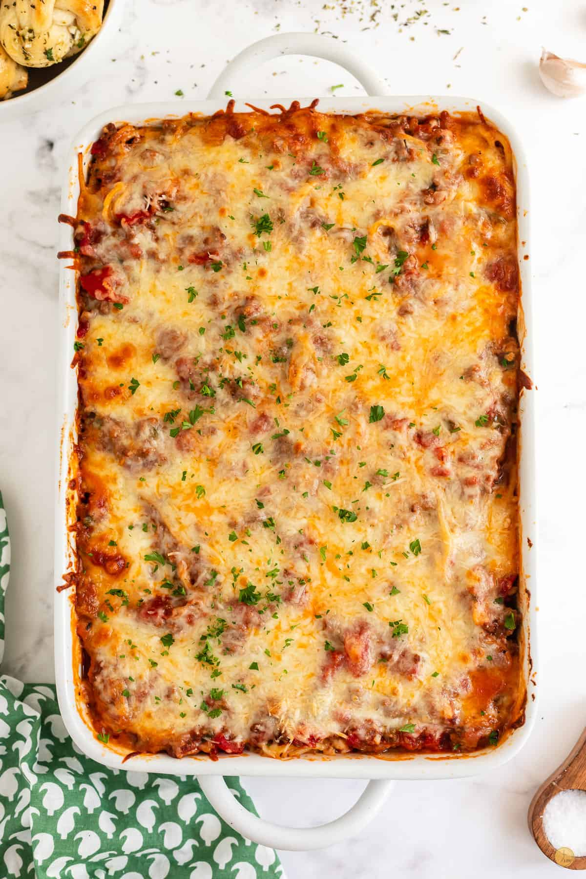 southern baked spaghetti in a casserole dish
