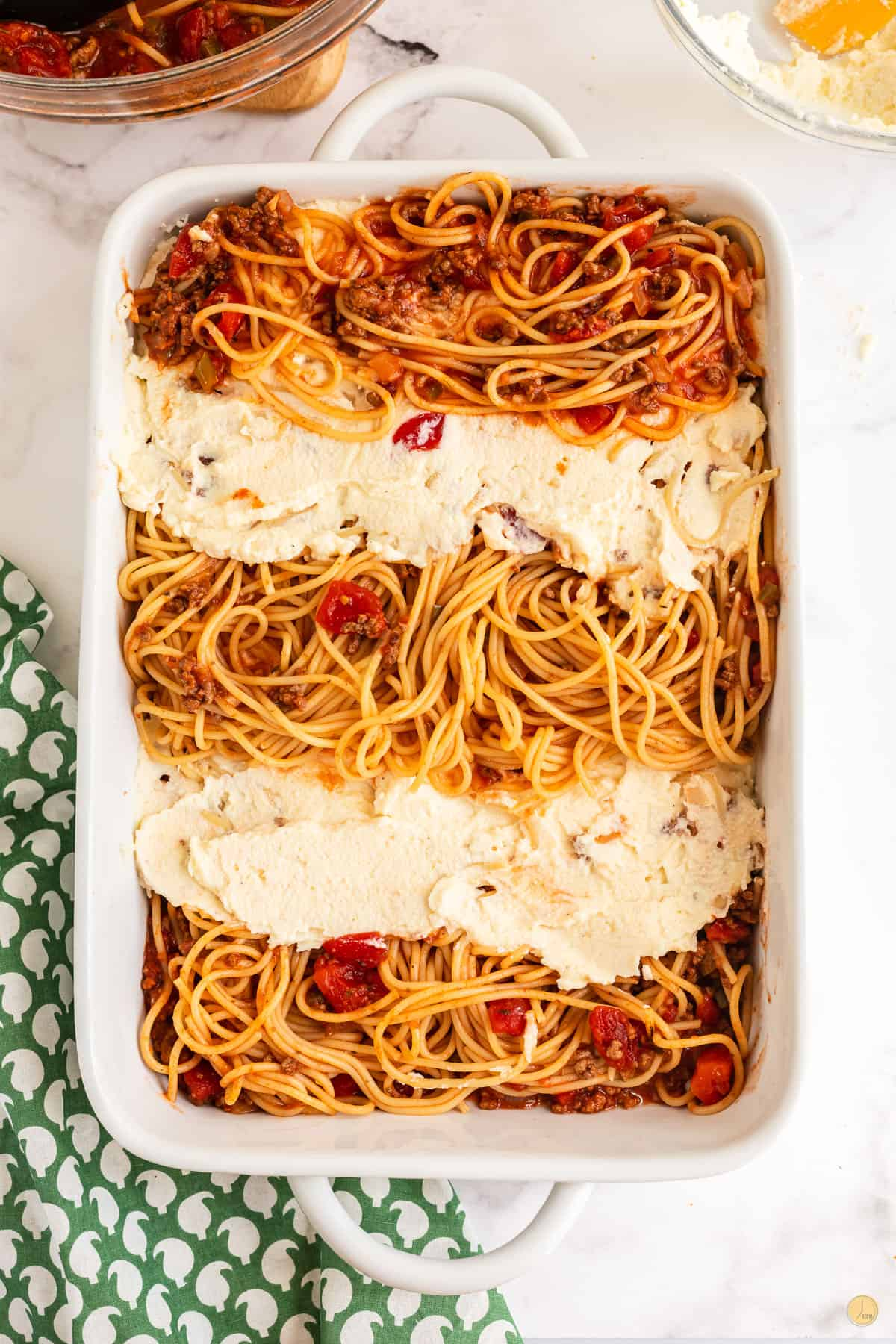 casserole dish with layers of pasta and cheese