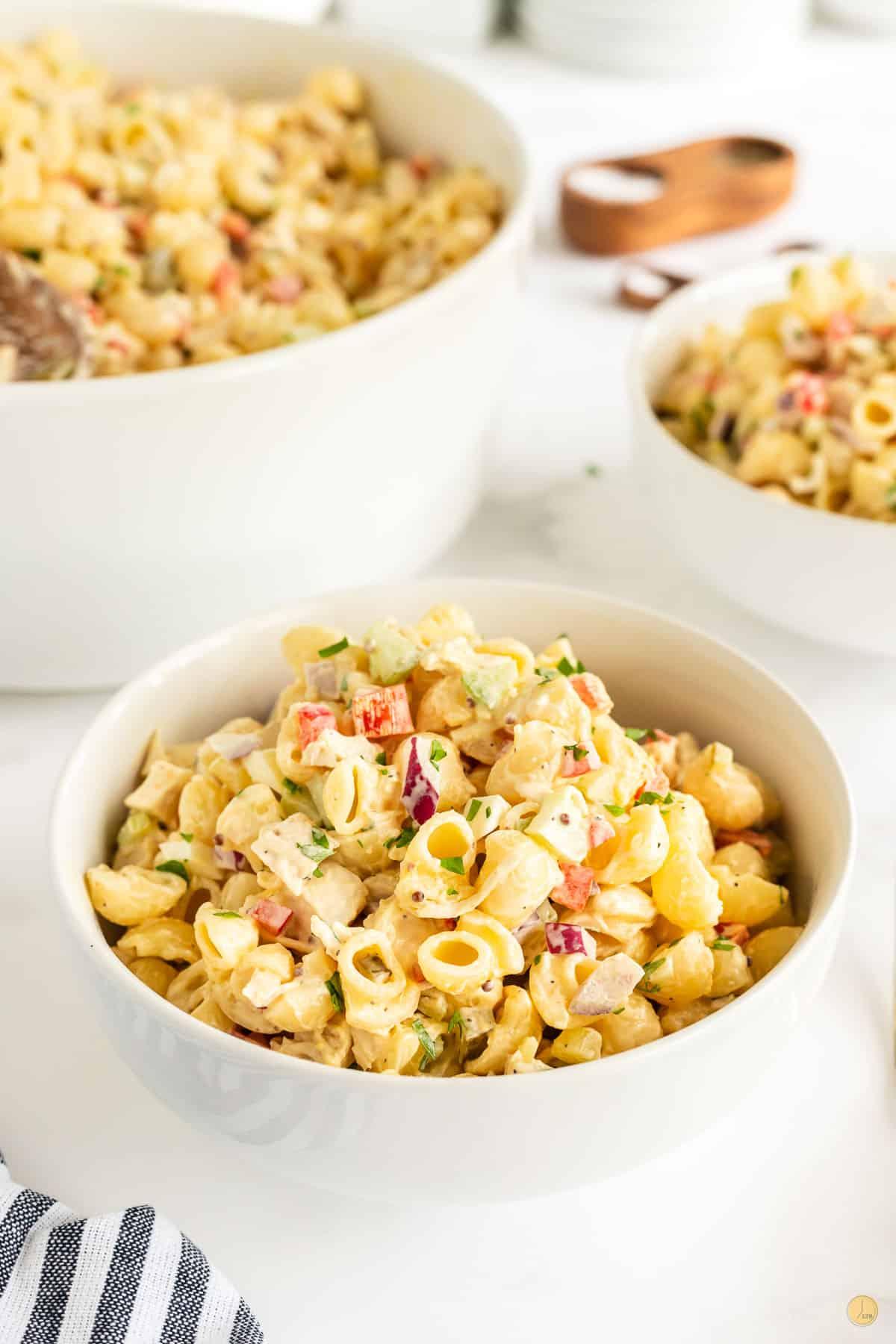 three bowls of macaroni salad