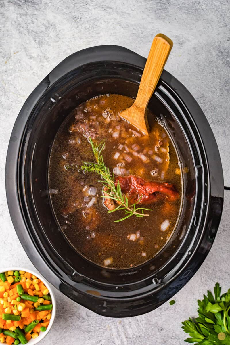 beef and herbs in a crock pot