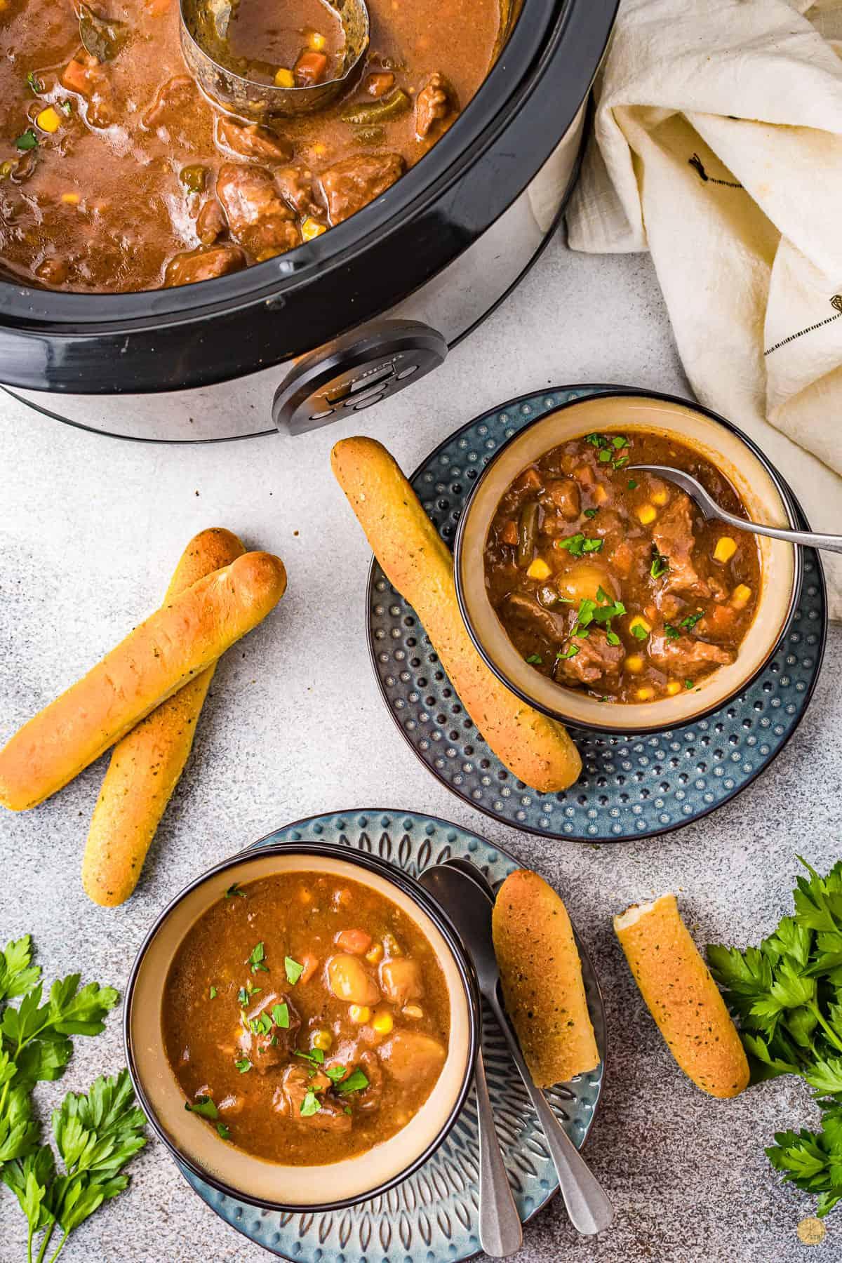 crock pot beef stew in bowls