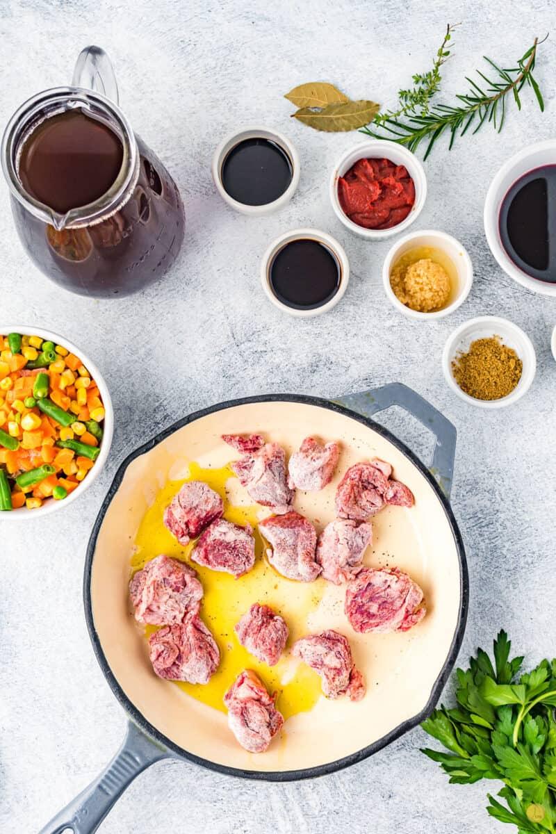 floured beef in a pan