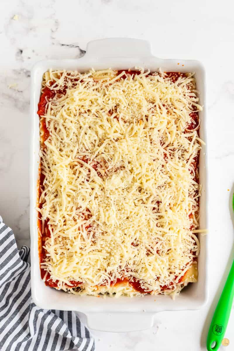 unbaked lasagna in a baking dish