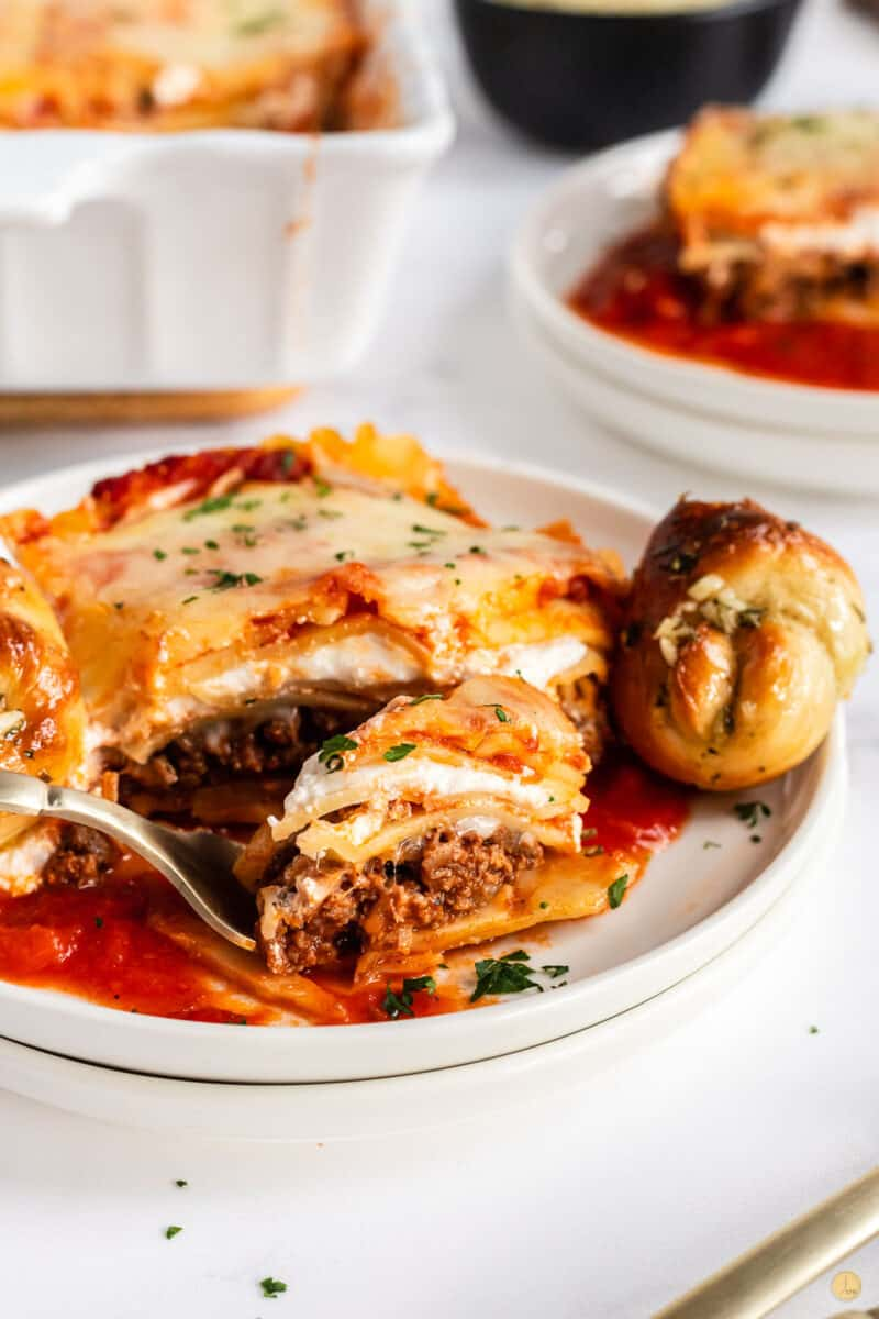 slice of lasagna on plate with fork