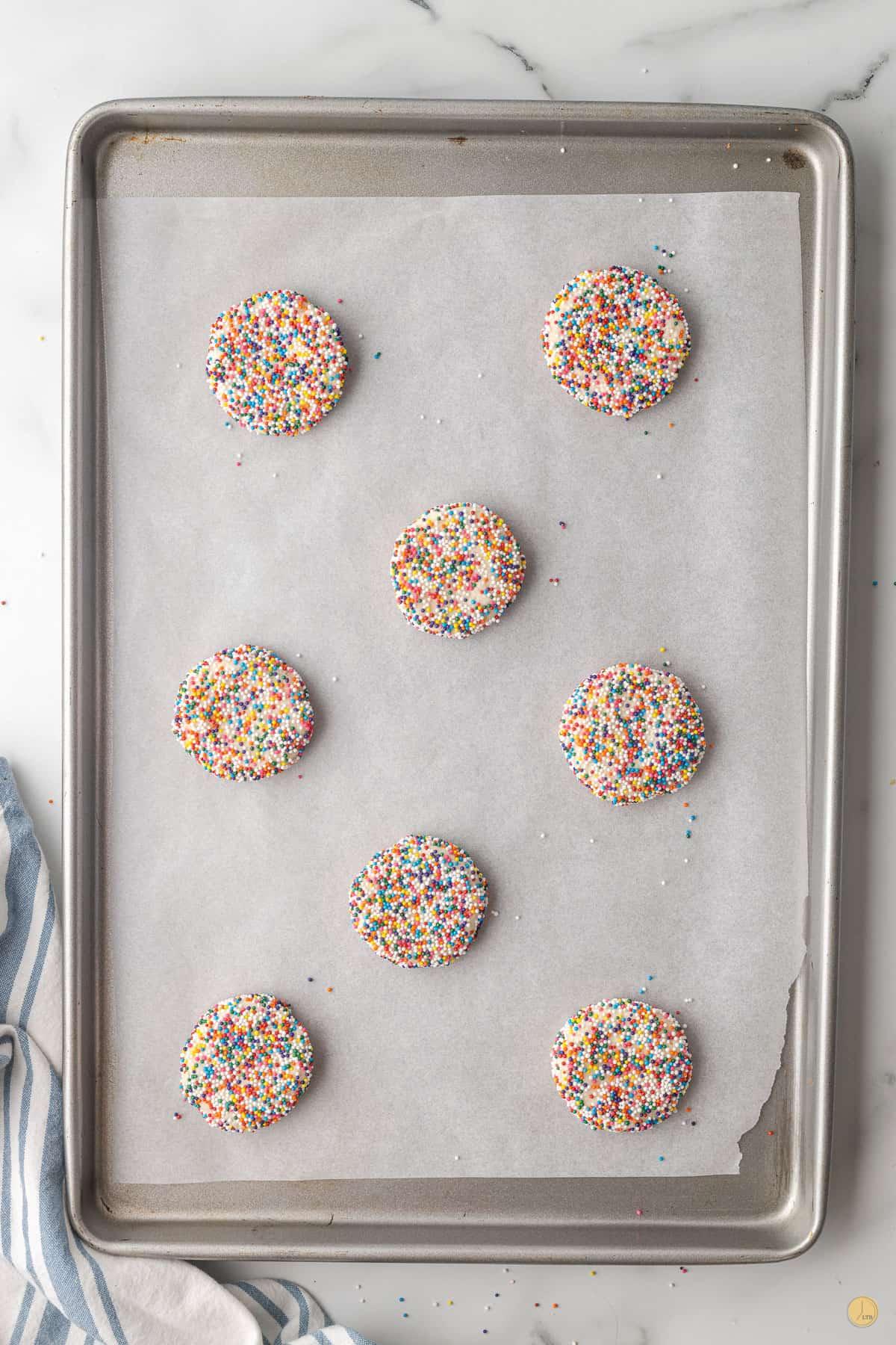 unbaked sprinkle cookies on a baking sheet