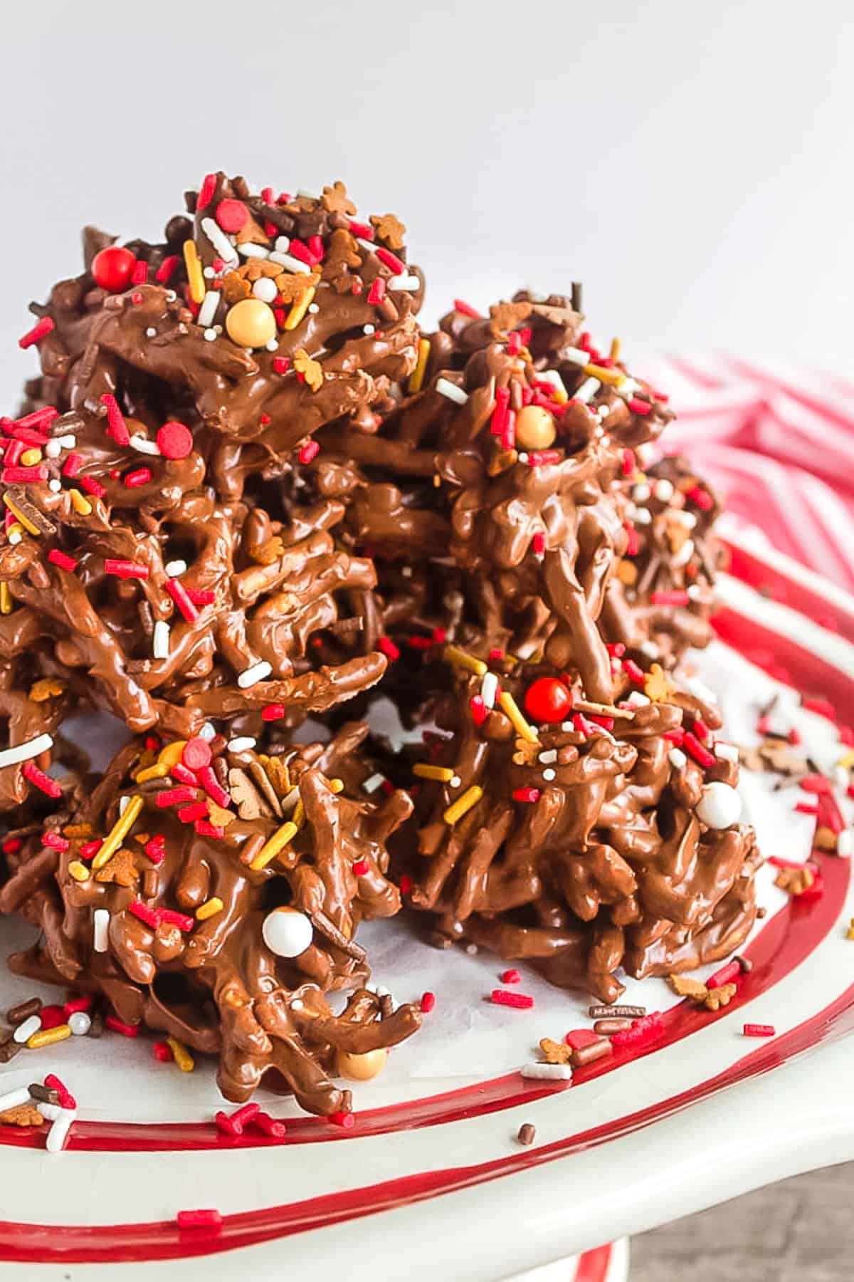 stack of cookies on a red and white platter