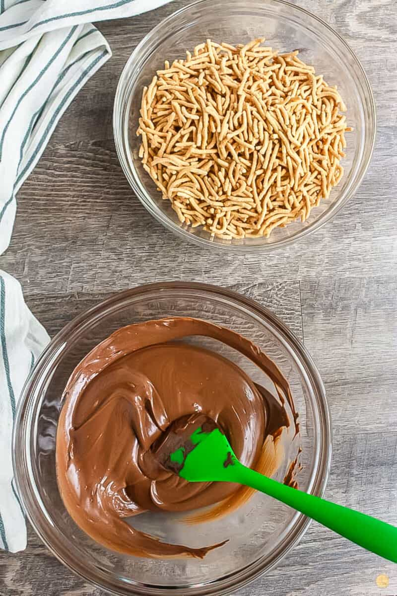 melted chocolate in a bowl with a green spatula