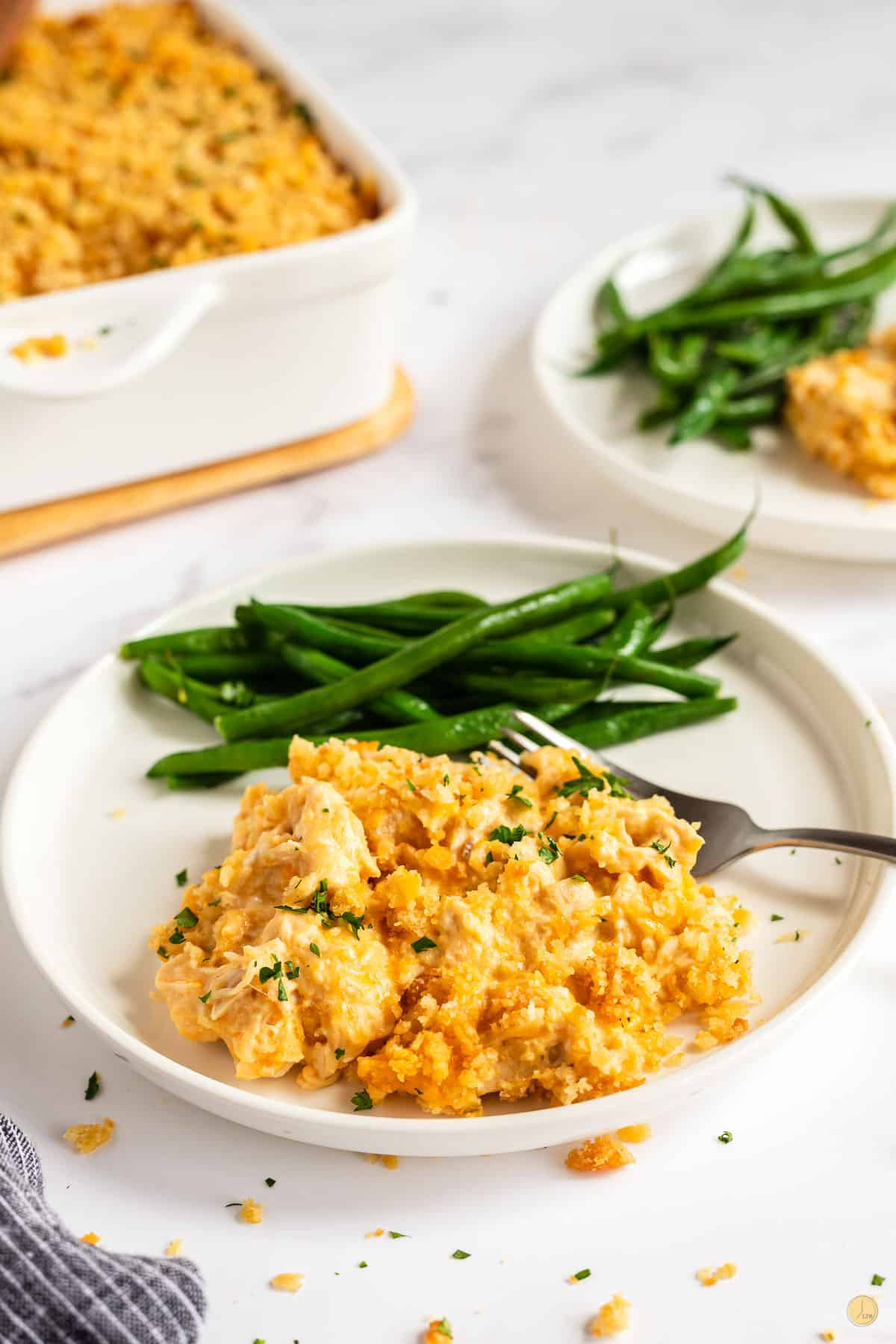 plate of million dollar chicken casserole and green beans