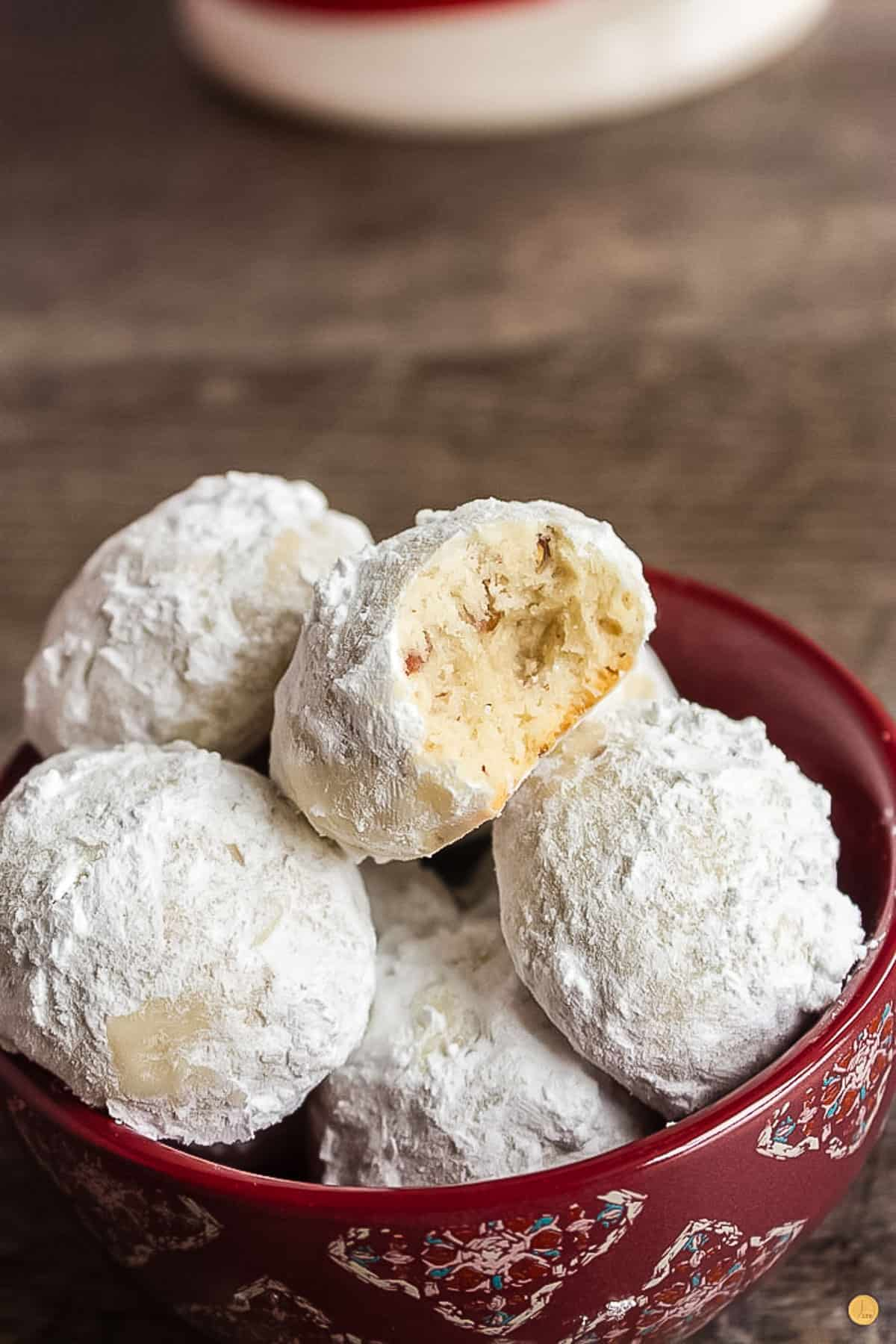 red bowl of pecan snowball cookies